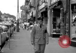 Image of Streets and shops of town Ottumwa Iowa USA, 1958, second 10 stock footage video 65675056276