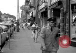 Image of Streets and shops of town Ottumwa Iowa USA, 1958, second 11 stock footage video 65675056276