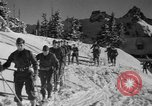 Image of first ski patrol of US Army Mount Rainier Washington USA, 1940, second 6 stock footage video 65675056282