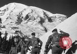 Image of first ski patrol of US Army Mount Rainier Washington USA, 1940, second 8 stock footage video 65675056282