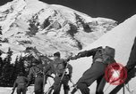 Image of first ski patrol of US Army Mount Rainier Washington USA, 1940, second 9 stock footage video 65675056282
