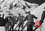 Image of first ski patrol of US Army Mount Rainier Washington USA, 1940, second 10 stock footage video 65675056282