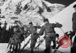 Image of first ski patrol of US Army Mount Rainier Washington USA, 1940, second 11 stock footage video 65675056282