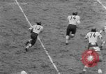 Image of West Catholic versus Bok Vocation Tech football Philadelphia Pennsylvania USA, 1951, second 6 stock footage video 65675056308