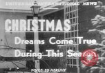 Image of children dreaming of Christmas toys in a shop window United States USA, 1951, second 1 stock footage video 65675056310