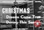 Image of children dreaming of Christmas toys in a shop window United States USA, 1951, second 2 stock footage video 65675056310