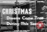 Image of children dreaming of Christmas toys in a shop window United States USA, 1951, second 3 stock footage video 65675056310