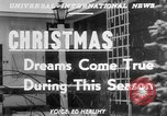 Image of children dreaming of Christmas toys in a shop window United States USA, 1951, second 4 stock footage video 65675056310