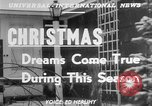 Image of children dreaming of Christmas toys in a shop window United States USA, 1951, second 5 stock footage video 65675056310