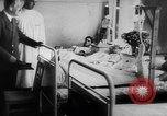Image of Hitler visits bomb plot victims in hospital East Prussia, 1944, second 10 stock footage video 65675056336