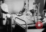 Image of Hitler visits bomb plot victims in hospital East Prussia, 1944, second 11 stock footage video 65675056336