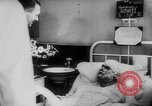 Image of Hitler visits bomb plot victims in hospital East Prussia, 1944, second 12 stock footage video 65675056336