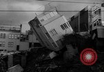 Image of Buildings collapse from flood erosion United States USA, 1965, second 3 stock footage video 65675056505