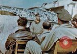 Image of pilots briefed Germany, 1945, second 11 stock footage video 65675056548
