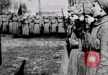 Image of Leon Trotsky presents colors to new unit of Red Guards Russia, 1917, second 1 stock footage video 65675056579