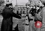 Image of Leon Trotsky presents colors to new unit of Red Guards Russia, 1917, second 3 stock footage video 65675056579