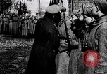 Image of Leon Trotsky presents colors to new unit of Red Guards Russia, 1917, second 4 stock footage video 65675056579
