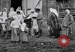 Image of Russian children receiving milk from local Soviet Russia, 1918, second 1 stock footage video 65675056584