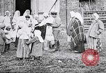 Image of Russian children receiving milk from local Soviet Russia, 1918, second 2 stock footage video 65675056584