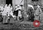 Image of Russian children receiving milk from local Soviet Russia, 1918, second 3 stock footage video 65675056584