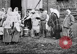 Image of Russian children receiving milk from local Soviet Russia, 1918, second 4 stock footage video 65675056584