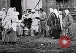 Image of Russian children receiving milk from local Soviet Russia, 1918, second 5 stock footage video 65675056584