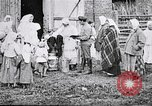 Image of Russian children receiving milk from local Soviet Russia, 1918, second 6 stock footage video 65675056584