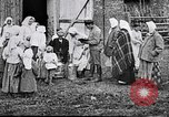 Image of Russian children receiving milk from local Soviet Russia, 1918, second 7 stock footage video 65675056584