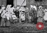 Image of Russian children receiving milk from local Soviet Russia, 1918, second 8 stock footage video 65675056584