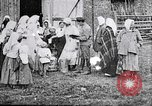 Image of Russian children receiving milk from local Soviet Russia, 1918, second 9 stock footage video 65675056584