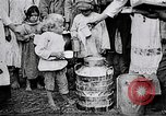 Image of Russian children receiving milk from local Soviet Russia, 1918, second 10 stock footage video 65675056584