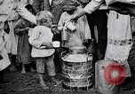 Image of Russian children receiving milk from local Soviet Russia, 1918, second 11 stock footage video 65675056584