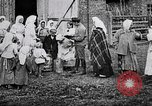 Image of Russian children receiving milk from local Soviet Russia, 1918, second 12 stock footage video 65675056584