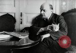 Image of Vladimir Lenin with his cat Russia, 1917, second 2 stock footage video 65675056590