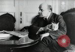Image of Vladimir Lenin with his cat Russia, 1917, second 4 stock footage video 65675056590