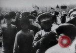 Image of march by demonstrators Russia, 1917, second 1 stock footage video 65675056599