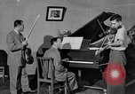 Image of David Fyodorovich Oistrakh  playing violin Moscow Russia Soviet Union, 1946, second 1 stock footage video 65675056632