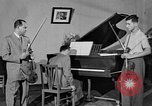 Image of David Fyodorovich Oistrakh  playing violin Moscow Russia Soviet Union, 1946, second 9 stock footage video 65675056632