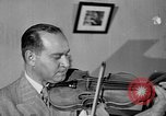 Image of David Fyodorovich Oistrakh  playing violin Moscow Russia Soviet Union, 1946, second 10 stock footage video 65675056632