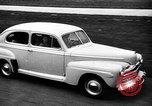Image of first Ford model year 1946 cars Detroit Michigan USA, 1945, second 5 stock footage video 65675056677