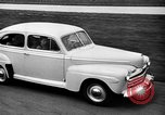 Image of first Ford model year 1946 cars Detroit Michigan USA, 1945, second 6 stock footage video 65675056677