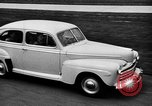 Image of first Ford model year 1946 cars Detroit Michigan USA, 1945, second 7 stock footage video 65675056677