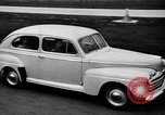 Image of first Ford model year 1946 cars Detroit Michigan USA, 1945, second 8 stock footage video 65675056677