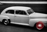 Image of first Ford model year 1946 cars Detroit Michigan USA, 1945, second 9 stock footage video 65675056677