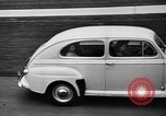 Image of first Ford model year 1946 cars Detroit Michigan USA, 1945, second 11 stock footage video 65675056677