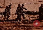 Image of Wounded marines carried to Higgins boats Iwo Jima, 1945, second 2 stock footage video 65675056725