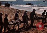 Image of Wounded marines carried to Higgins boats Iwo Jima, 1945, second 3 stock footage video 65675056725