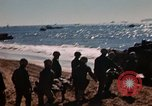 Image of Wounded marines carried to Higgins boats Iwo Jima, 1945, second 5 stock footage video 65675056725