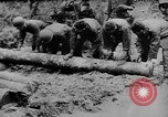 Image of US Soldiers labor and haul equipment Pacific Theater, 1944, second 3 stock footage video 65675056745