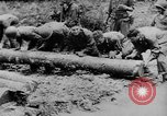 Image of US Soldiers labor and haul equipment Pacific Theater, 1944, second 6 stock footage video 65675056745